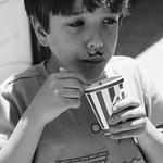 2nd Grader eating Rita`s Water Ice in Logan Square Park in Philadelphia, Pennsylvania
