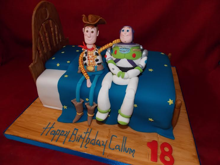Toy Story Cake with Handcrafted Buzz and Woody by Louise Stuart of Caked in Sugar