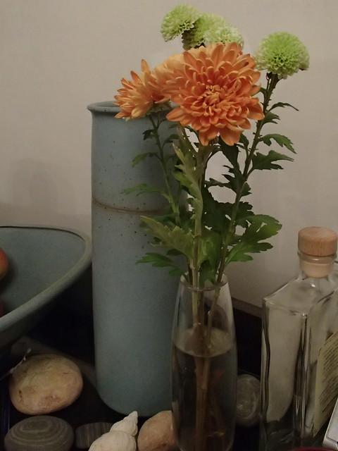 A bud vase of chrysanthemums