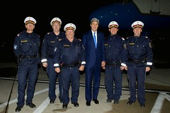 U.S. Secretary of State John Kerry poses with members of the local traffic police who supported his visit to Vienna, Austria, on November 24, 2014, during P5+1 and European Union-nation negotiations with Iran about the future of its nuclear program. [State Department photo/ Public Domain]