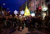 The end of the procession is marked by a large Christmas tree lantern and two stars