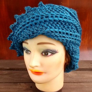 Absorb yourself in the color of sparkling and exhilarating water in ocean blue. The unique and whimsical shaped women's crochet LAUREN beanie hat guarantees style and comfort. The asymmetrical brim with a zigzag edge is infinity twist inspired from the mo