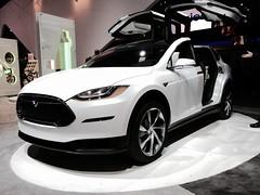 ford motor company(0.0), sedan(0.0), automobile(1.0), tesla(1.0), automotive exterior(1.0), vehicle(1.0), performance car(1.0), automotive design(1.0), auto show(1.0), bumper(1.0), land vehicle(1.0), luxury vehicle(1.0),