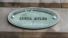 Photo of Lynda Myles green plaque