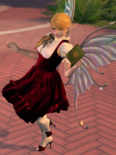 Image Description: Woman in a red dress with a white blouse running along a pink brick path.