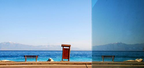 blue sea sky mountains reflection window glass closet bench mirror horizon mirage trick effect ruleofthirds