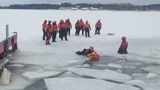 Coast Guard rescue personnel participate in ice rescue drills during a Ready for Operations conference near Coast Guard Station Portage in Dollar Bay, Mich., Dec. 10, 2014. Twenty-four members representing RFO teams from throughout the service attended the four-day conference and will now help instruct other ice rescue teams throughout the Coast Guard. (U.S. Coast Guard photo)