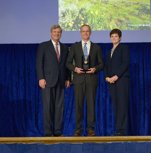 Agriculture Secretary Tom Vilsack and Agriculture Deputy Secretary Krysta Harden present the Secretary's Honor Award to the Pioneers Alliance group leader Michael S. Stevens at the U.S. Department of Agriculture 66th Annual Honor Awards Ceremony in Washington, D.C. USDA photo by Lance Cheung.