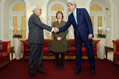 U.S. Secretary of State John Kerry shakes hands with Foreign Minister Javad Zarif of Iran while watched by Baroness Catherine Ashton of the European Union before sitting down in Vienna, Austria, on November 20, 2014, for a three-way discussion about the future of Iran's nuclear program. [State Department photo/ Public Domain]