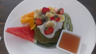 Spinach and Banana Pancakes with Seasonal Fruit, Vanilla Cashew Cream and Maple Glaze at Greenhouse Factory
