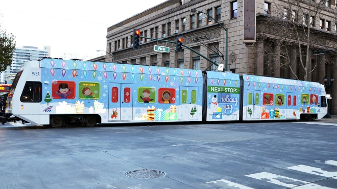 Photo of VTA's holiday wrapped train in downtown San Jose.