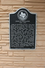 Photo of John R. Holland black plaque