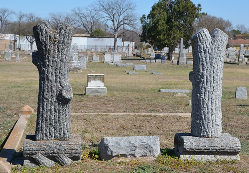 Backs of two Woodmen of the World grave monuments
