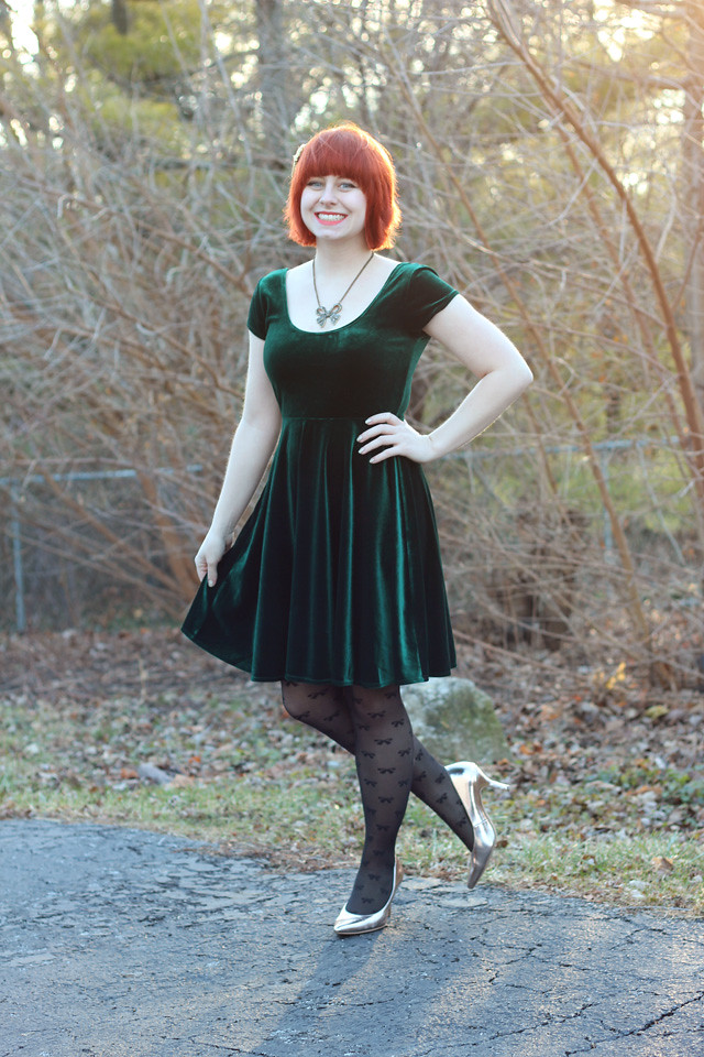 Christmas Outfit: Green Velvet Dress, Bow Print Tights, and Rose Gold Pumps