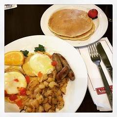 Eggs Benedict with sausage, breakfast potatoes, and pancakes 🍳😋 #breakfast #hhonors #hiltonhhonors