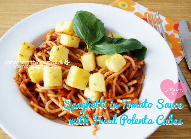 Spaghetti in tomato sauce with polenta cubes