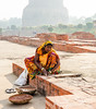 Indian woman repairing ruins - Deer Park