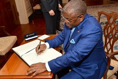 Angolan Foreign Minister Georges Chikoti signs the Secretary of State's guestbook before participating in the U.S.-Angola Strategic Dialogue with Secretary Kerry at the U.S. Department of State in Washington, D.C., on December 17, 2014. [State Department photo/ Public Domain]