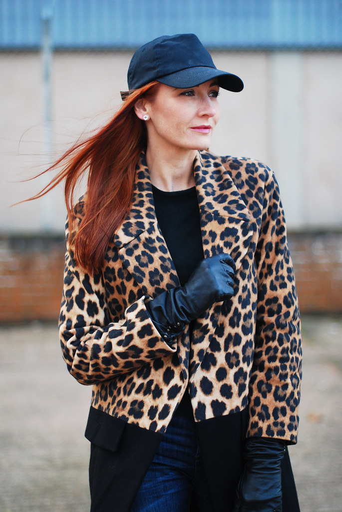 Leopard print coat with baseball cap