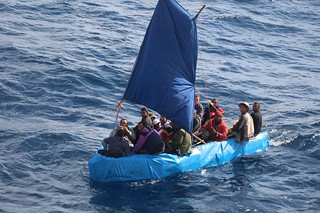 uban migrants sail a rustic vessel south of Key West, Florida, Jan. 1, 2015. The Coast Guard Cutter Mohawk interdicted the 24 Cuban migrants and were later repatriated to Bahia de Cabañas, Cuba. U.S. Coast Guard photo.