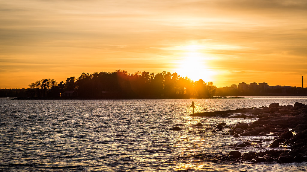 Fishing at sunset, Helsinki, Finland picture