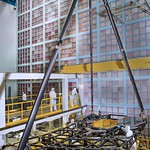 Inside a giant clean room at NASA's Goddard Space Flight Center in Greenbelt, Maryland, the pathfinder telescope, a practice section of the James Webb Space Telescope, stands fully assembled. Teams of engineers built and aligned the pathfinder telescope to rehearse assembly and testing before the actual telescope is built.
