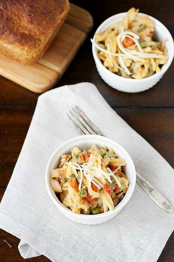 creamy pasta bake with chicken, tomatoes, and peas