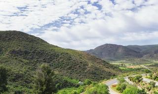 Image of Cango Caves. blue sky clouds landscape southafrica himmel wolken hills blau landschaft südafrika westerncape oudtshoorn hügel cangocaves