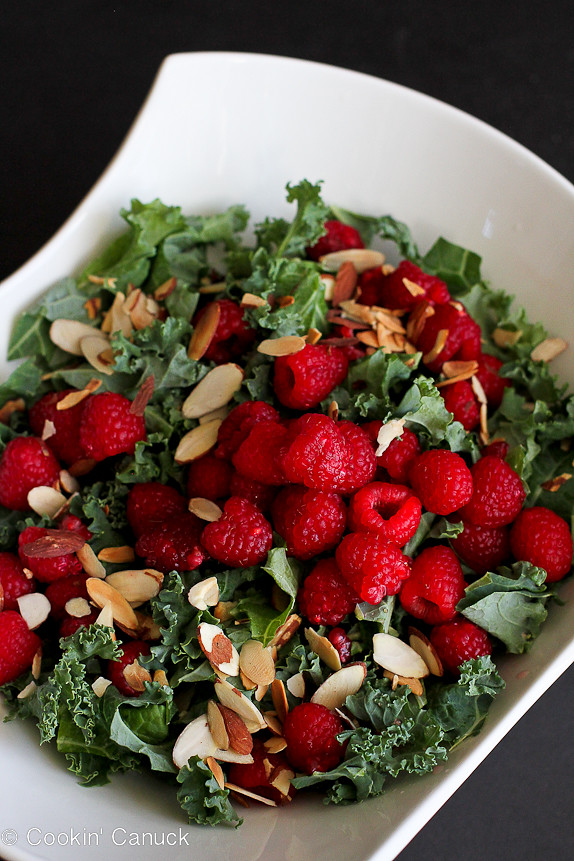 Kale Salad with Raspberries and Parmesan Crisps...A taste of summer at any time of the year! 138 calories and 4 Weight Watchers PP   cookincanuck.com #vegetarian #glutenfree #recipe #healthy
