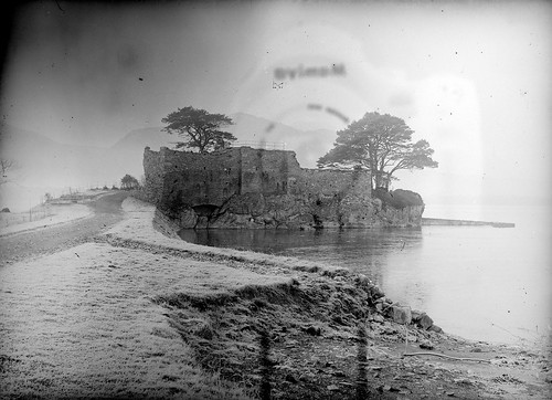 ireland winter lake castle frost ruin kerry killarney mccarthy mor camerareflection glassnegative nationallibraryofireland locationidentified ferguso'connor ferguso'connorcollection