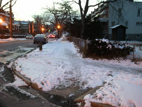 Unshovelled sidewalk and street corners