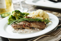 Beef with rosemary, mushroom sauce, broccoli and c…