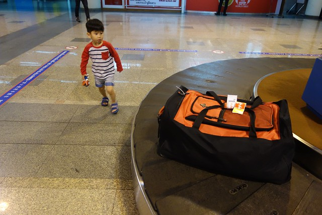 Kid running after our luggage. Too cute to look at.