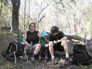 Numerous bushwalk rest stops to keep the 3 year old happy 20030420-17-warrumbingles-sharing-snack-on-track-p4200002