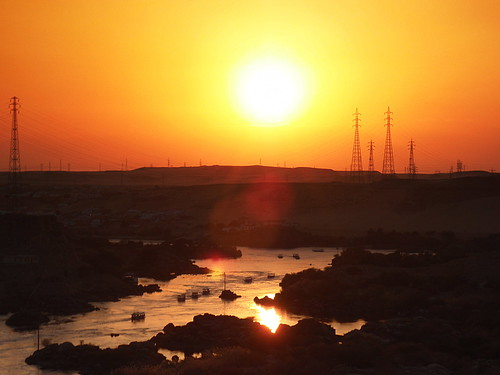 africa trip travel sunset vacation orange holiday reflection water yellow reflections river boats photography boat photo holidays glow desert photos egypt pylon nile electricity traveling aswan nubia cataract traveler nubian egyptians beautifulsunset rivernile redsunrise 1stcataract mustseeplaces