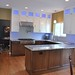 After kitchen remodel. Custom cabinetry, granite tops, Multi colored L.E.D. lighting and new stainless appliances.