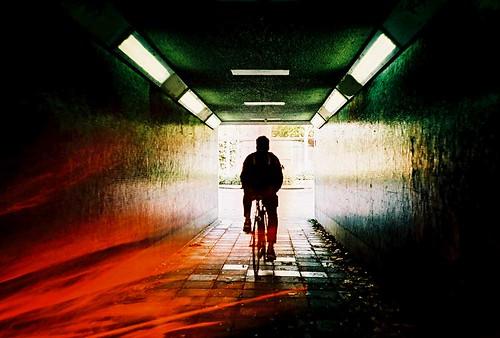 sunset film bicycle silhouette dark lomo lca xpro lomography xprocess cyclist shadows doubleexposure crossprocess lofi tunnel analogue subterranean expiredfilm kodakelitechrome extracolor ebx filmswap