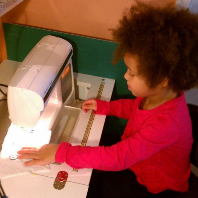 First time operating the sewing machine all by herself (with very close supervision from Mommy) to make a gift for her one-year-old cousin. Age 4 1/2. She was extremely careful.#sewing #sewingwithkids (tagging @fireapplefarm )