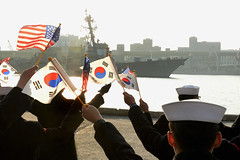 Republic of Korea (ROK) Navy sailors assigned to ROK 1st Fleet welcome USS Mustin (DDG 89) as the ship arrives in Donghae, Jan. 11. (Photo courtesy of Republic of Korea Navy)