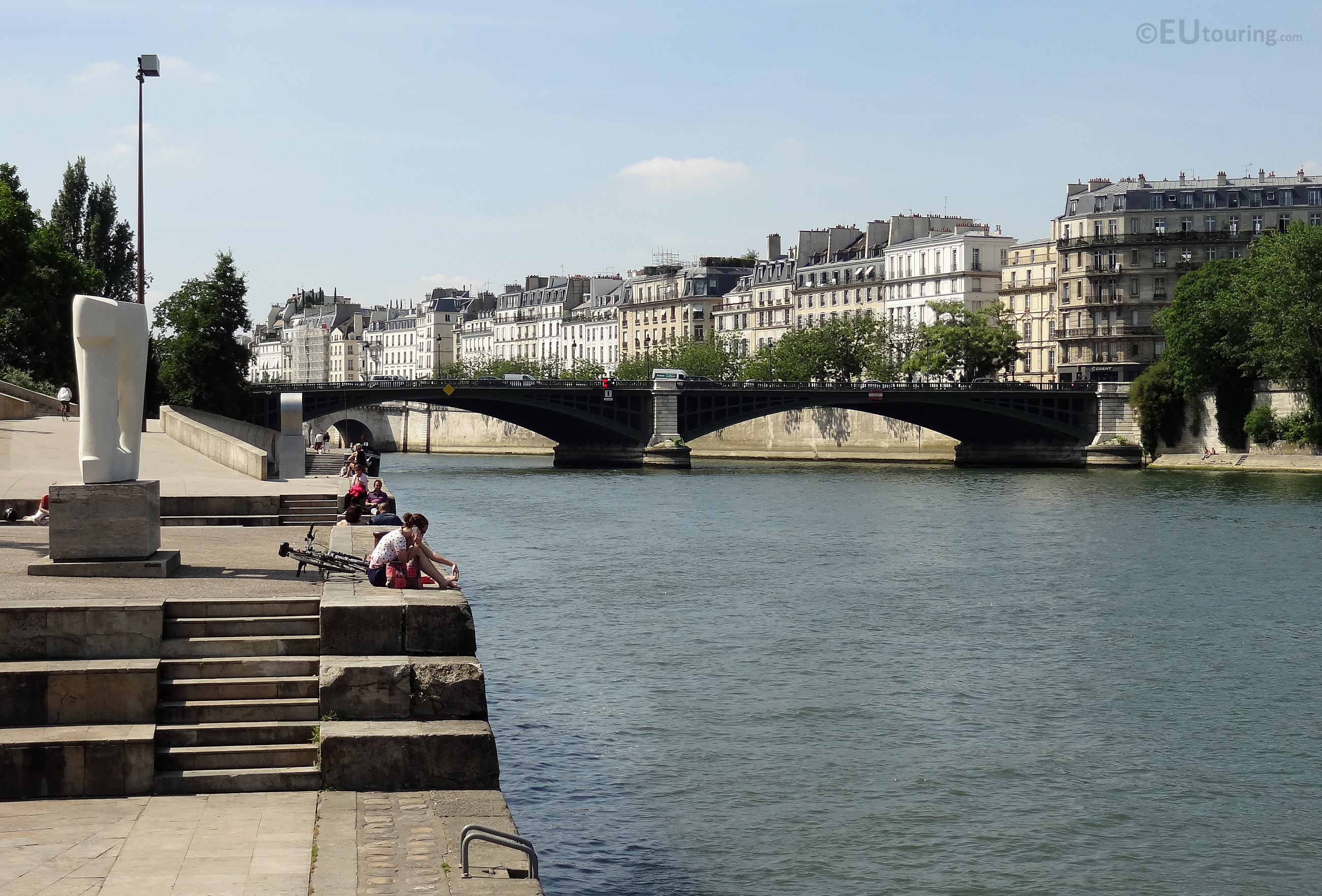 Relaxing by the Seine and bridge
