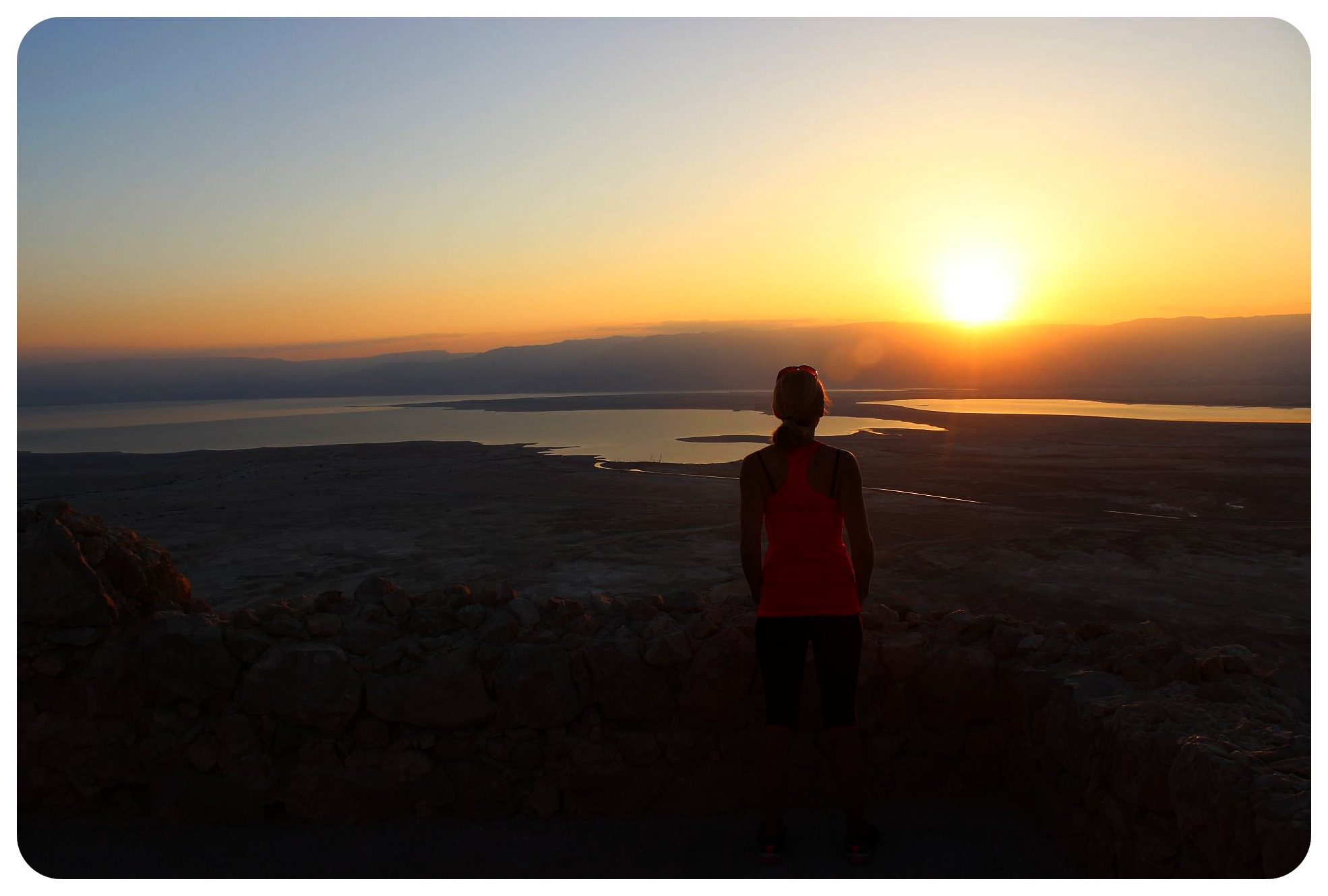 dani watching the sunrise over the dead sea