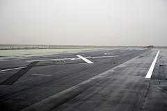 aircraft(0.0), aviation(0.0), airplane(0.0), wing(0.0), vehicle(0.0), walkway(0.0), flight(0.0), horizon(1.0), airport(1.0), infrastructure(1.0), tarmac(1.0), runway(1.0),