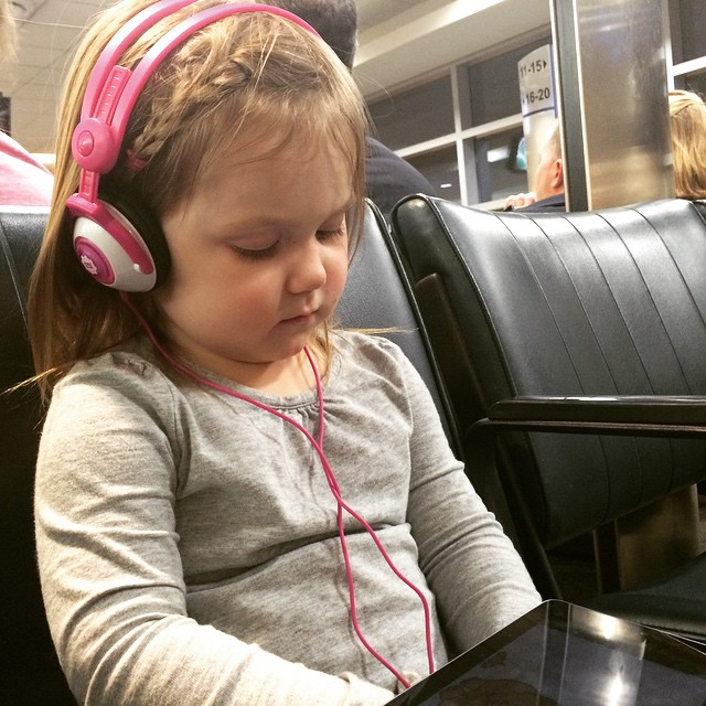 Watching video way past her bedtime at our new gate, because today is just that sort of day. #winterbreak2014 #midwayairport