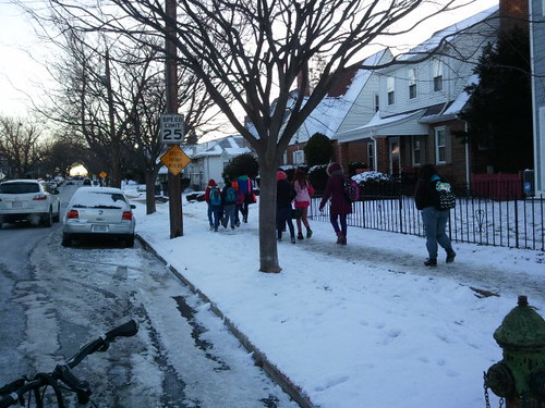 Children walking to school in the snow