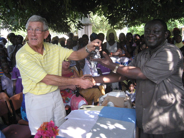 Geoffrey Henson hands the clinic keys to Soutey Drammeh