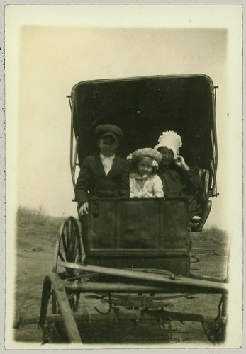 Three Children in a Buggy