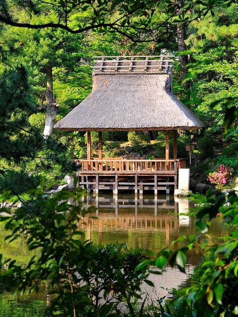 Thatched pavilion over pond