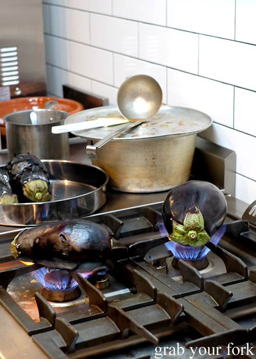 Roasting eggplants over flames at The Black Groodle, Ultimo