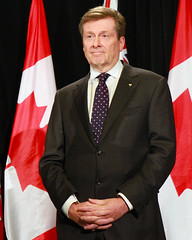 John Tory Standing with Canadian Flags