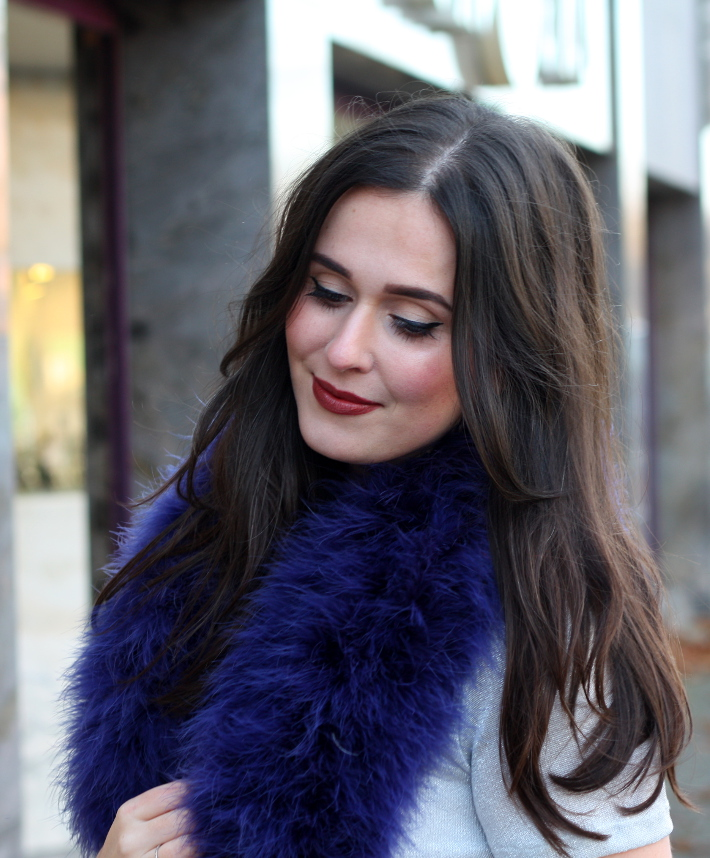 cat eye brown lipstick feather boa
